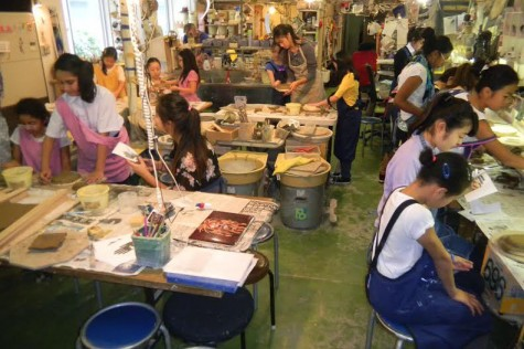 The Human Rights and Refugees Class working with fifth graders with pottery making.