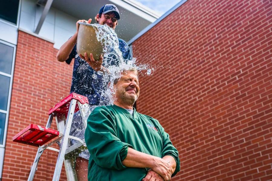 Green Bay local radio and TV personality John Maino performs the ALS Ice Bucket Challenge.