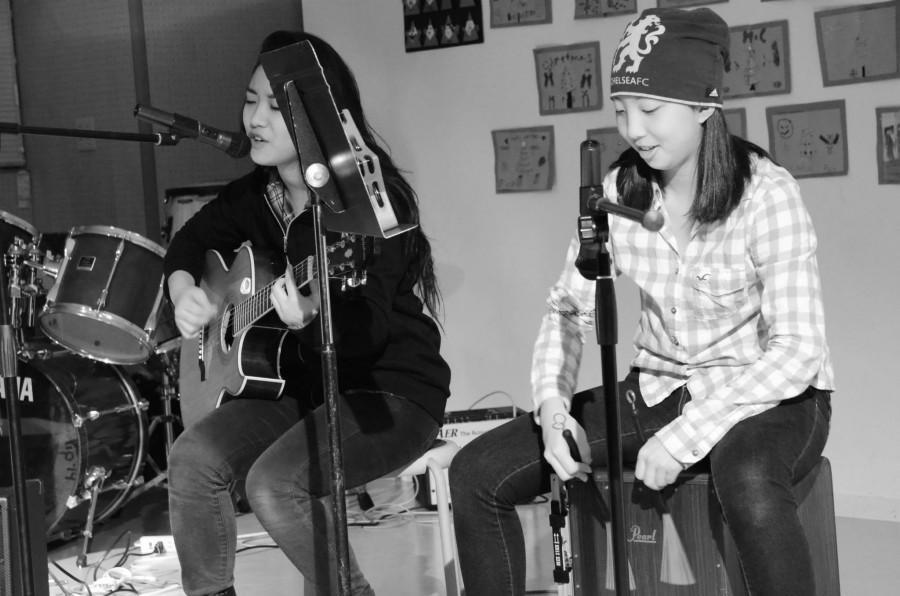 Moeka (11) and Haruka (11) sing