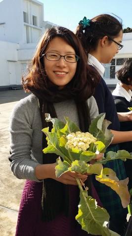 Julia (12) holding a freshly harvested Cauliflower