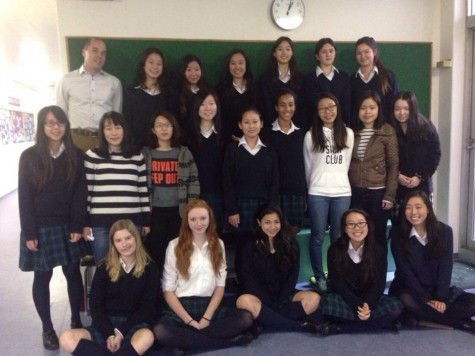 The Room to Read club that started last year, now consists of 24 members, and sponsor Mr. Gray. Photo: Mizuki