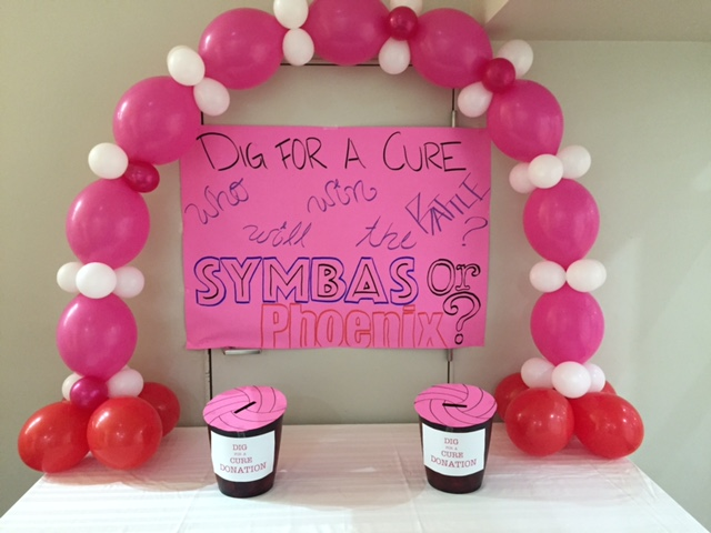 Donation boxes for breast cancer research were placed around the gym.