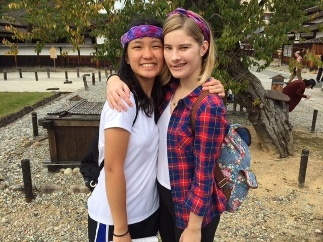(From left to right) Theint Theint (11) and Tori (11) in the grade tie dye bandanas.