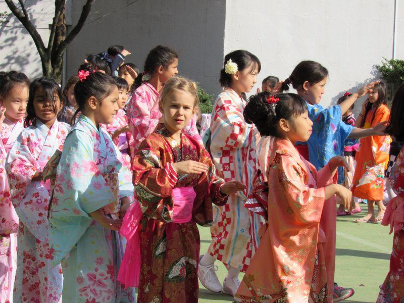 Junior school children perform the Bon odori eager for the middle and high school students to join in.