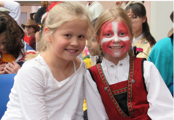 The two girls wait to represent their country, Denmark, in the Parade Of Nations.