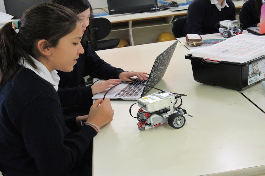 Students turn the robot on.