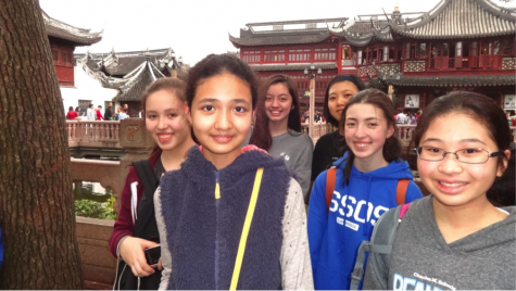 Hello from Shanghai! Sacred Heart conference participants pose in front of an ancient temple. Photo: B. Shull