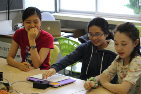 Middle School students laughing in a round of Brain Bowl.