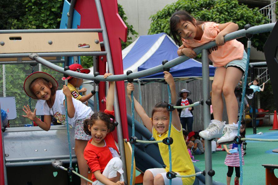 Yippee! Junior schoolers are enjoying their recess in the kindergarten playground.
