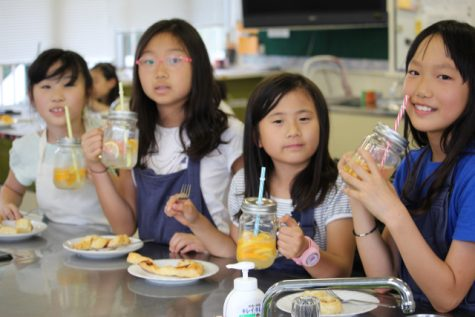 That looks delicious! Junior schoolers taste the recipes they made in Global Kitchen.