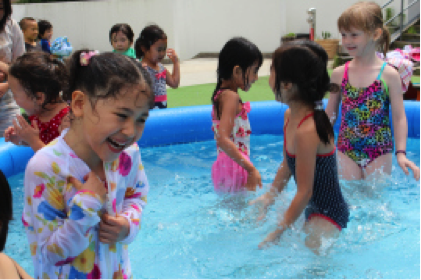 Kindergarten students cool off during Splash Time!