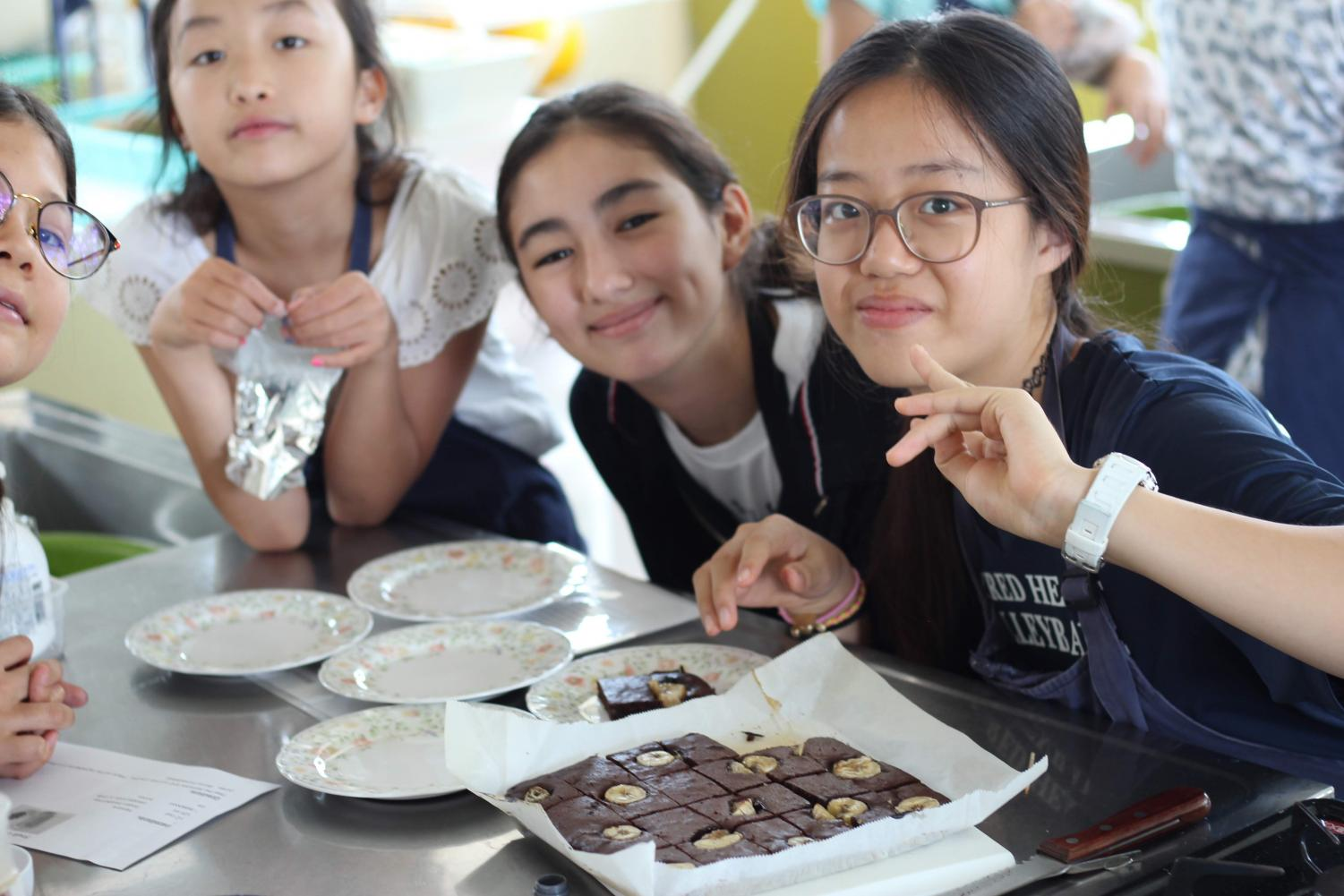 Rafaa shares banana brownies with her cooking group in Just Desserts.