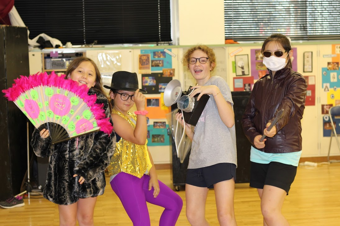 Students in the Drama course have fun with props and costumes.