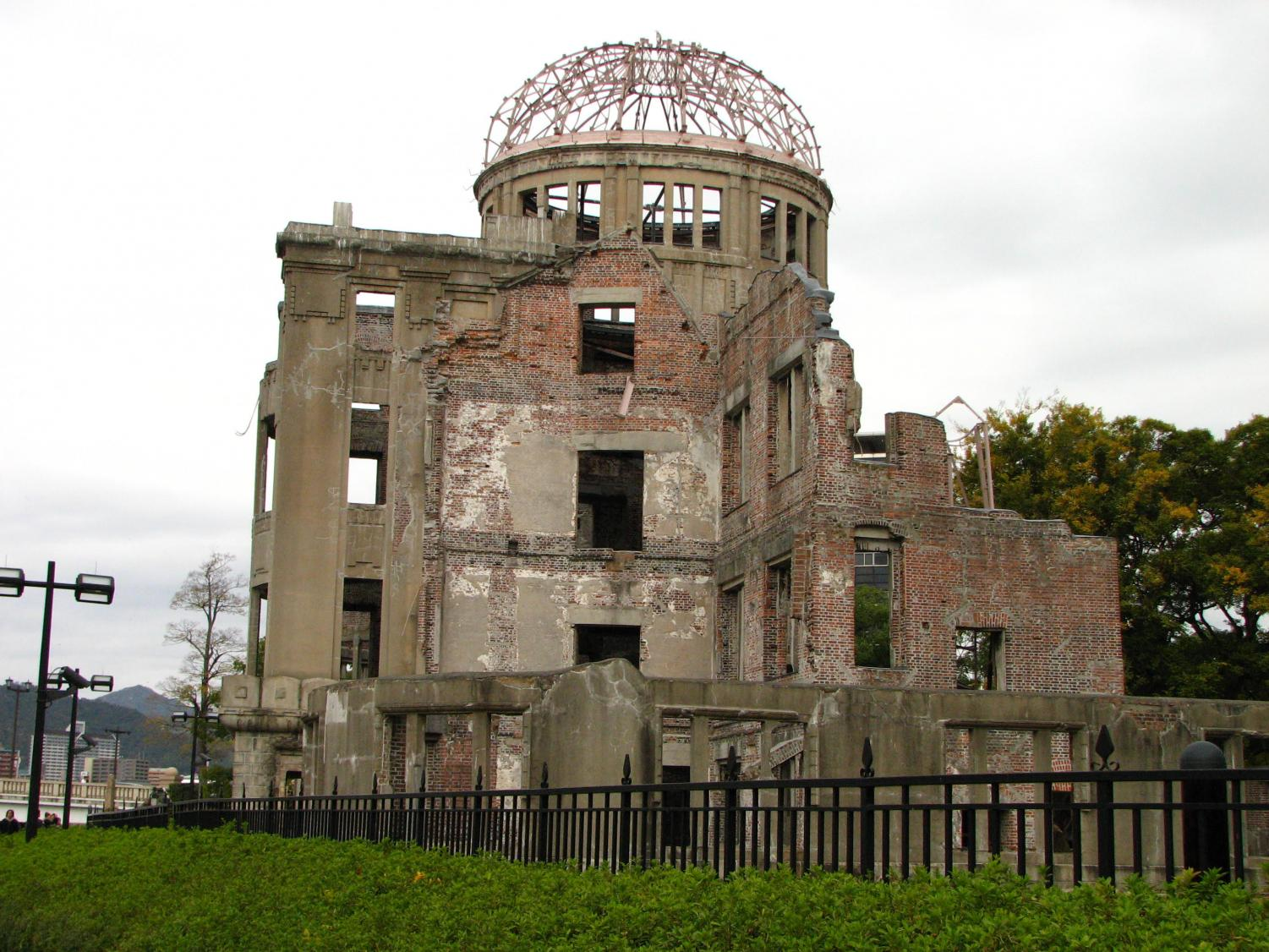 This is a photograph of the A-Bomb Dome, also known as the Hiroshima Peace Memorial. This building was one of the few buildings that remains standing since the bombing of the area in 1945.