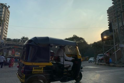Rickshaw taxis create a haze of smog as they run the streets of Mumbai.