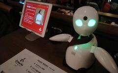 OriHime, a Bunshin robot, waiting on a table at Avatar Robot Cafe DAWN ver.β, Shibuya in January 2020.