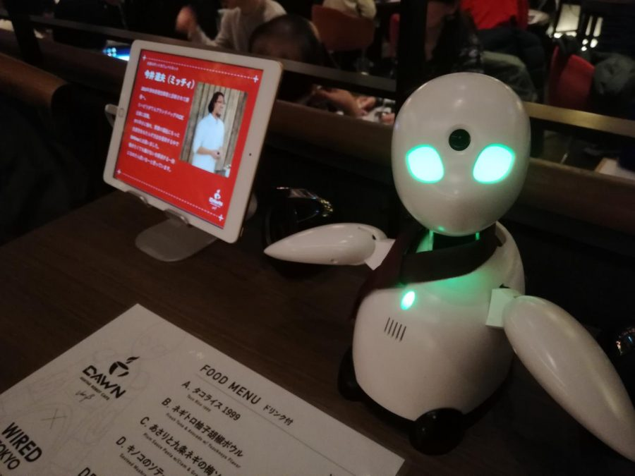 OriHime%2C+a+Bunshin+robot%2C+waiting+on+a+table+at+Avatar+Robot+Cafe+DAWN+ver.%CE%B2%2C+Shibuya+in+January+2020.%0A