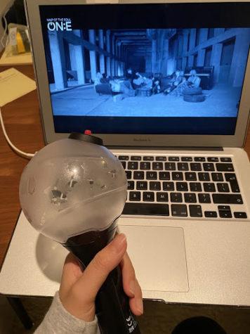 Hana K. enjoying a virtual concert for BTS MAP OF THE SOUL ON:E while holding her BTS light stick.  Photo Credit: Hana K.